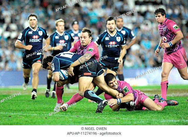 11 05 2012 Sydney, Australia Bulls scrum half Francois Hougaard and Morne Steyn tackle Waratahs winger Daniel Halangahu during the FxPro Super Rugby game...