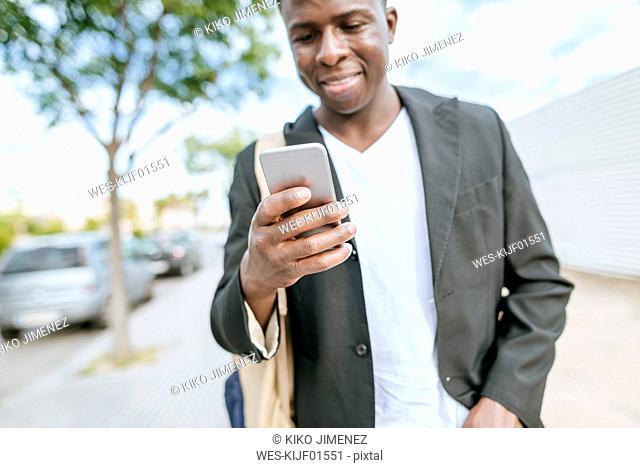 Man's hand holding smartphone