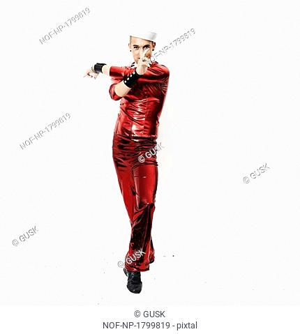 Portrait of a young gay man in red leather clothes