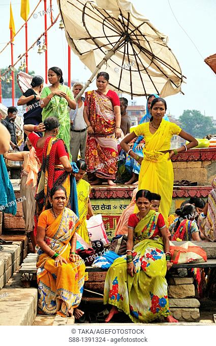 Pilgrims women at the ghat by the Ganges river