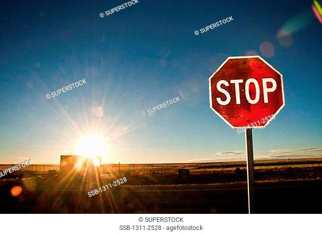 Stop sign at dusk, New Mexico, USA