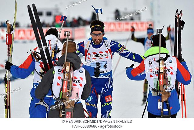The relay team of France with (L-R) Quentin Fillon Maillet, Marie Dorin Habert, Martin Fourcade and Anais Bescond celebrate winning the gold medal during the...