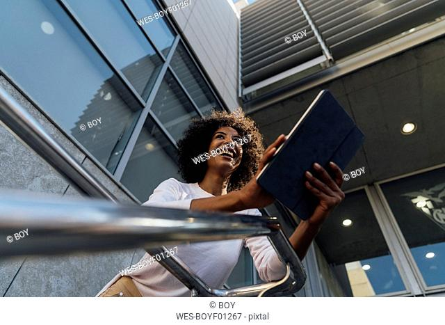 Young casual businesswoman using smartphone