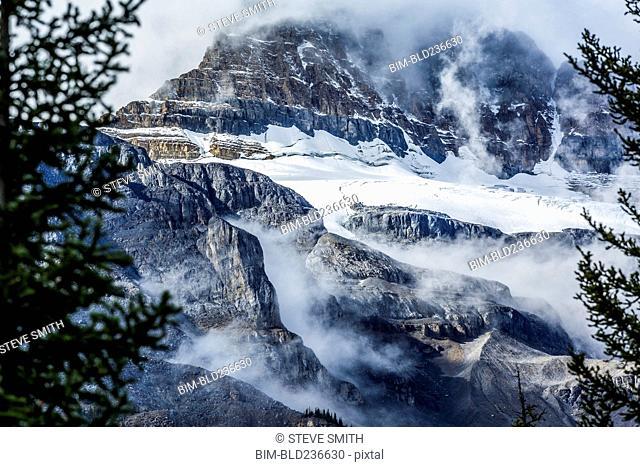 Fog on snowy mountain range
