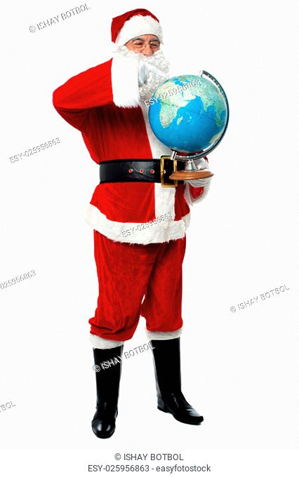Happy santa pointing at globe