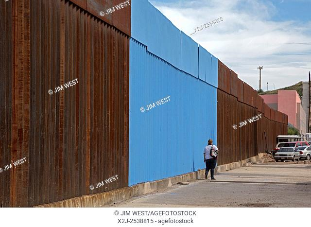 Nogales, Sonora Mexico - The Mexican side of the U. S. -Mexico border fence. Artist Ana Teresa Fernandez painted part of the fence blue so as to blend it with...