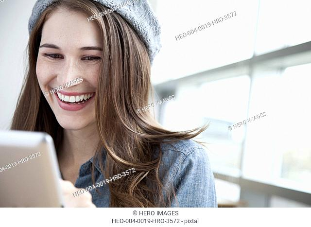 pretty student using pc tablet
