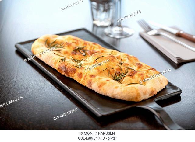 Garlic and herb Pinsa at Italian Restaurant