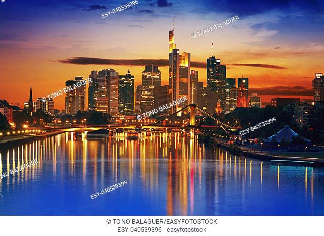 Frankfurt skyline at sunset in Germany with Meno river