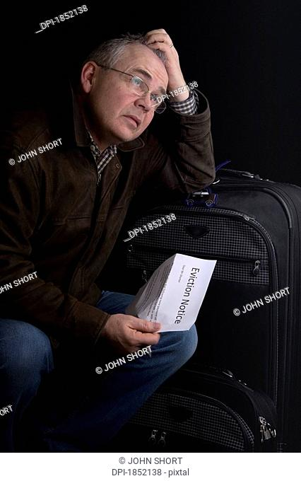 Man with suitcase, Man with an eviction notice