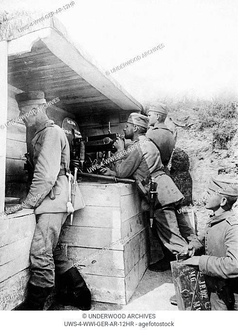 Europe: July 15, 1916 A German machine gun crew firing upon the enemy 200 meters away.The crew is under a bomb proof shelter and is firing 600 bullets a minute