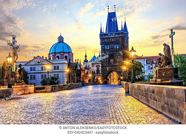 Charles Bridge and Old Town Bridge Tower in Prague at sunrise