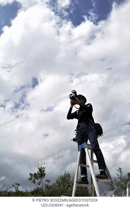 Henoko, Okinawa, Japan, a reporter photographing people protesting against the destruction of Henoko Bay to expand the American Marines Base of Camp Schwab