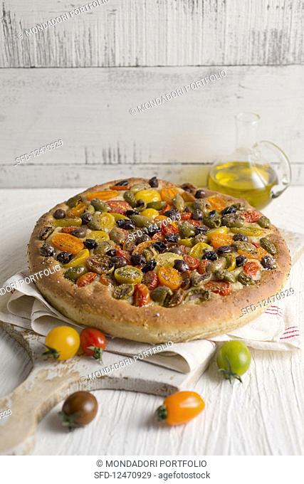 Colourful tomato focaccia with olives