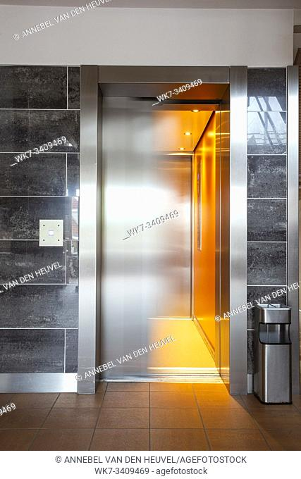 Building Elevator with moving door in apartment complex luxury silver