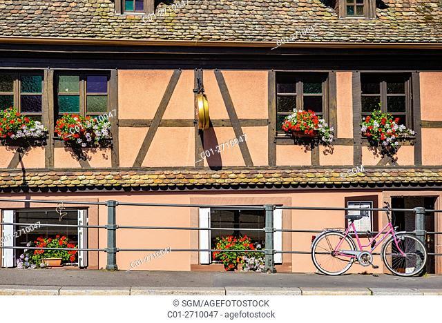 Half-timbered house, pink bike, La Petite France, Strasbourg, Alsace, France