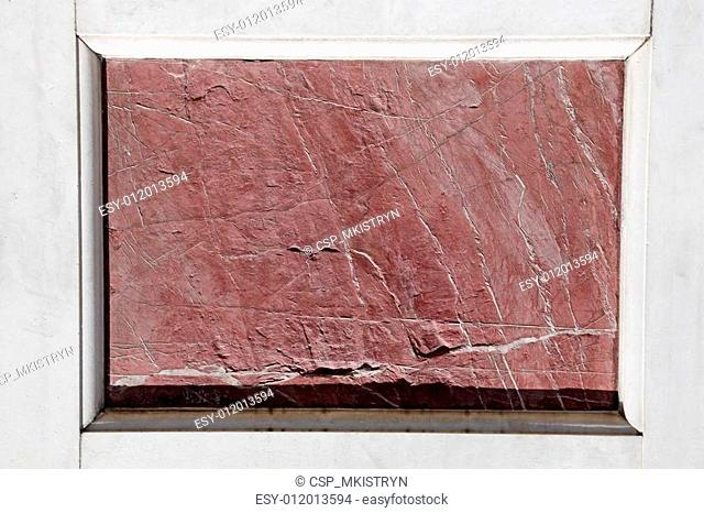 antique red marble slab framed with white marble