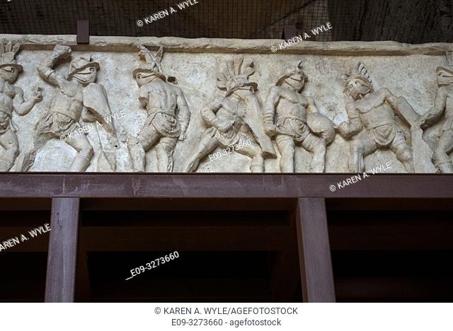 frieze from Colosseum on display inside, showing multiple gladiators - Rome, Italy