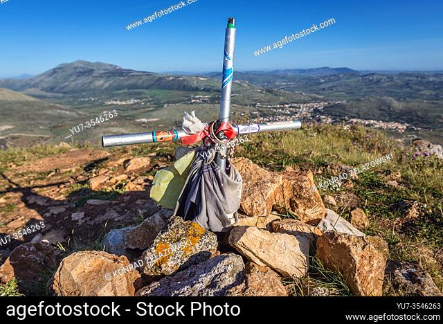 Cross on the top of Cofano Mountain in Monte Cofano nature reserve in the province of Trapani on Sicily Island in Italy