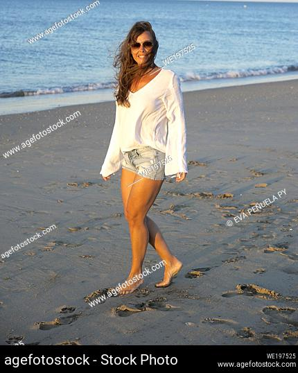 young girl enjoying comfortable morning clothes on the Islantilla beach, Huelva