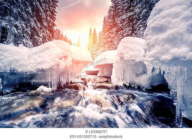 Miracle river at sunlight in the morning. Dramatic and picturesque wintry scene. Location Carpathian, Ukraine, Europe. Beauty world