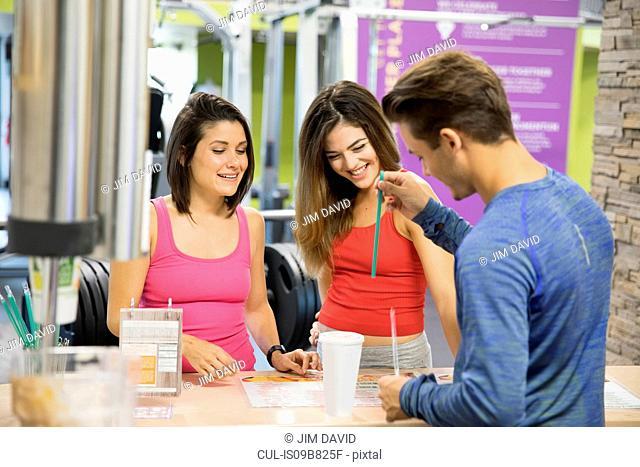 Friends taking break in gym