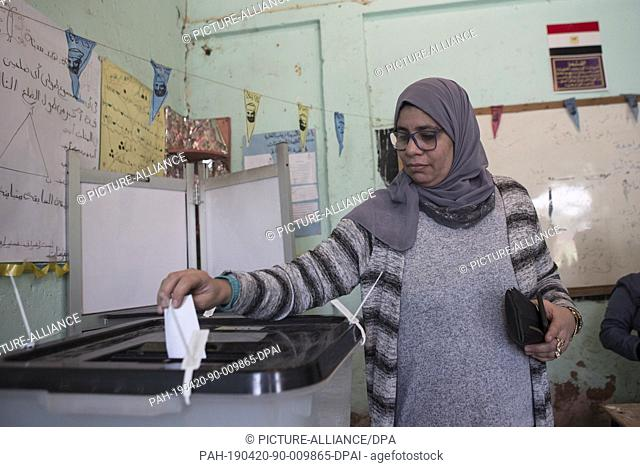 20 April 2019, Egypt, Cairo: A Woman casts her ballot on the first day of the national referendum on the constitutional amendments extending the presidential...