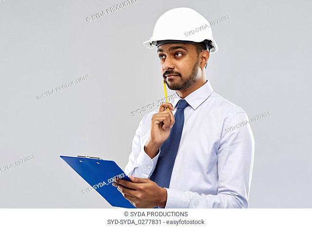 architect or businessman in helmet with clipboard