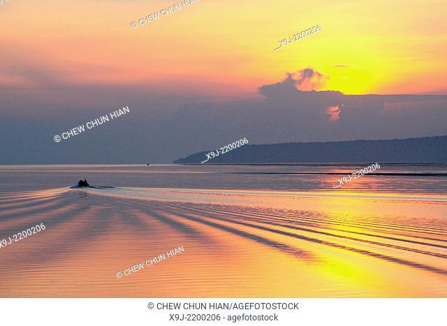 Sunrise at Buntal Fishing Village and Small fishing boats, kuching, Sarawak, malaysia