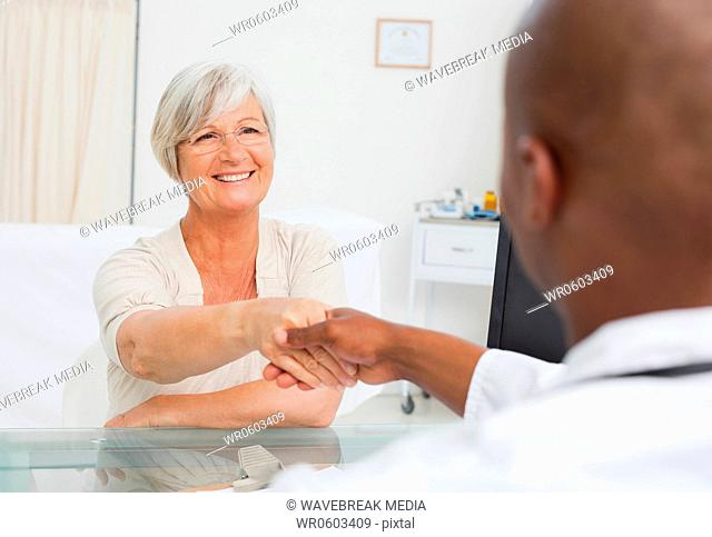 Woman greeting her doctor