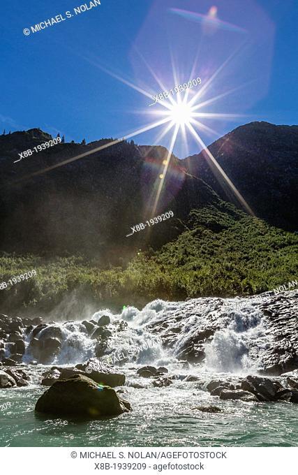 Snow-melt waterfall in Tracy Arm-Ford's Terror Wilderness area, Southeast Alaska, U.S.A