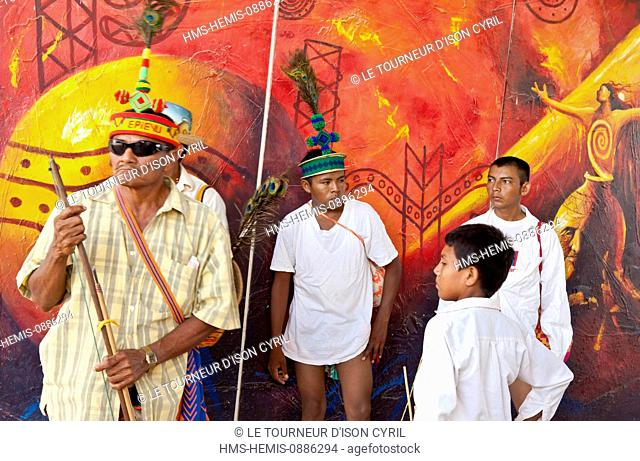 Colombia, Guajira Department, Uribia, men from the Wayuu community ahead a drawing symbolizing the Wayuu culture