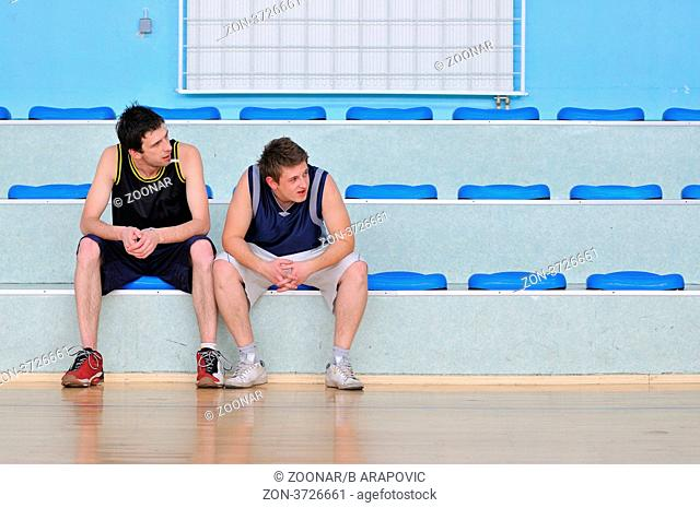basketball players relax and rest after hard game