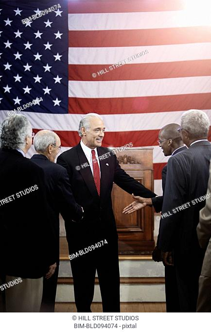 Politician shaking hands with supporters