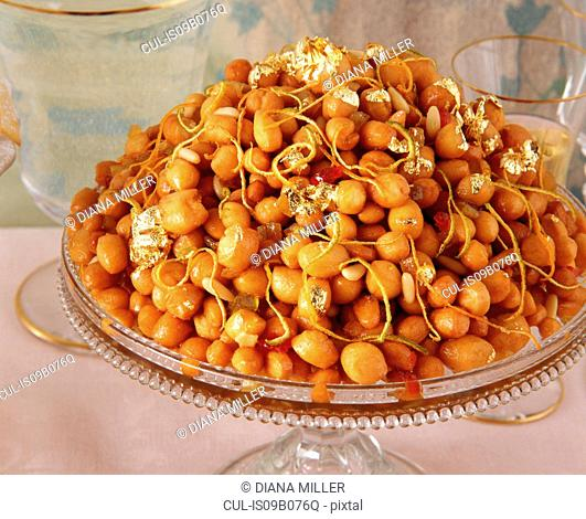 Traditional Italian party food, Cicerchiata, chick peas with gold leaf