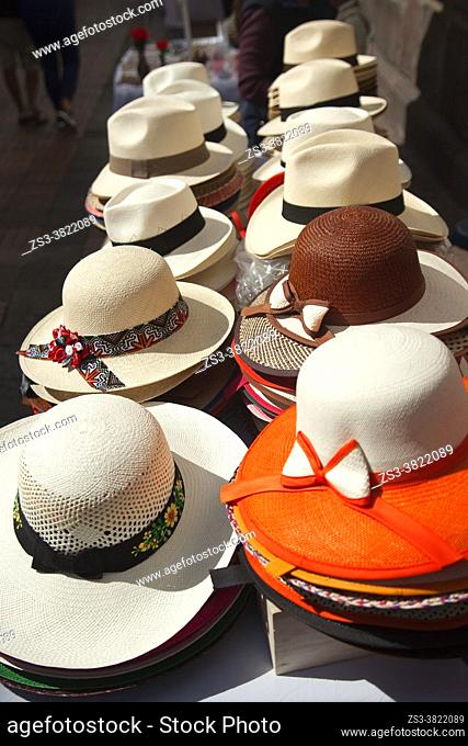 Colorful hats for sale at the street near Plaza Grande or Plaza De La Independencia in the historic center, Quito, Ecuador, South America