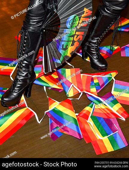 "01 July 2020, Berlin: Dragqueen Bambi Mercury is presenting the Pride collection of the Hard Rock Cafe Berlin under the motto """"All is One"""" with his boots..."