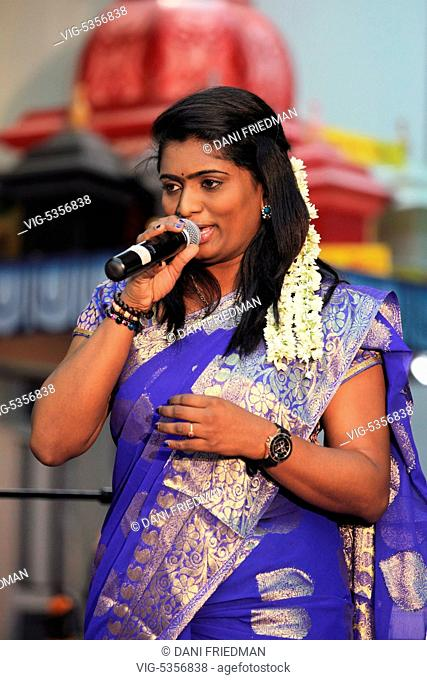 South Indian singer SONIA performs at a South Indian Hindu temple for devotees during the 2015 Aadivel Festival in Brampton Ontario, Canada