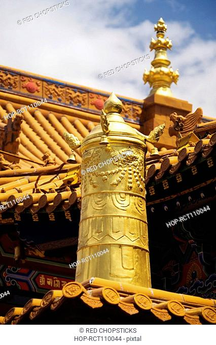 Low angle view of sculptures on the roof of a temple, Da Zhao Temple, Hohhot, Inner Mongolia, China