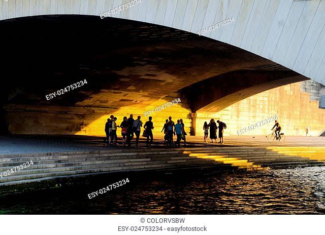 Seine embankment under Pont d'Iena in late afternoon light, Paris, France