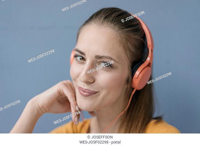 Portrait of a pretty woman, using headphones