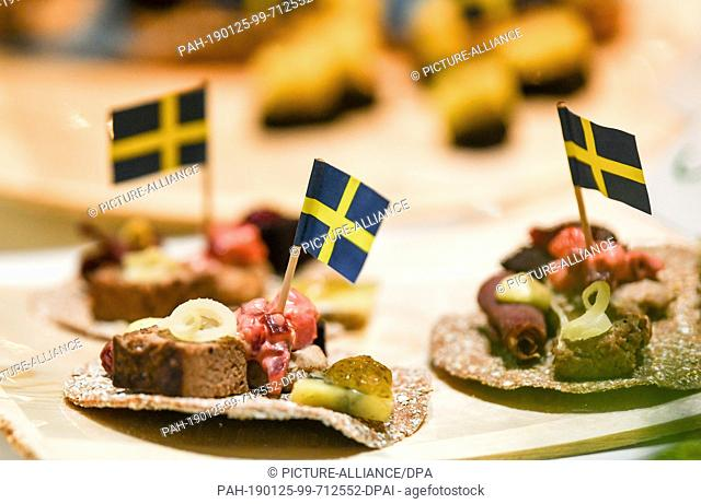 24 January 2019, Berlin: Snacks with cheese and Swedish flags are available for visitors at the International Green Week