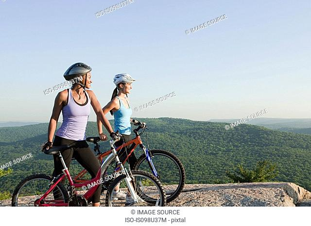 Two female cyclists, rural scene