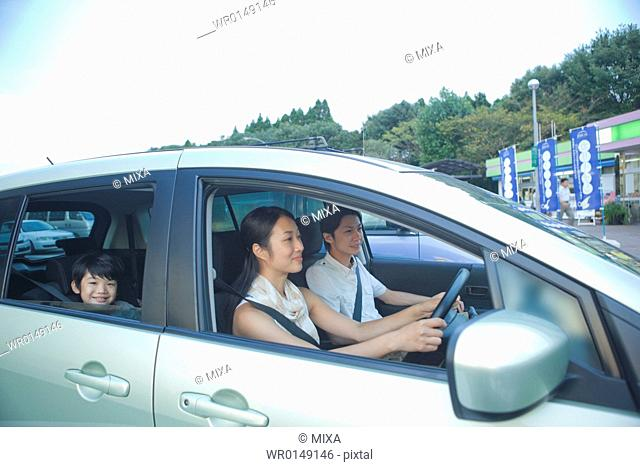Family Parking a Car at Service Area