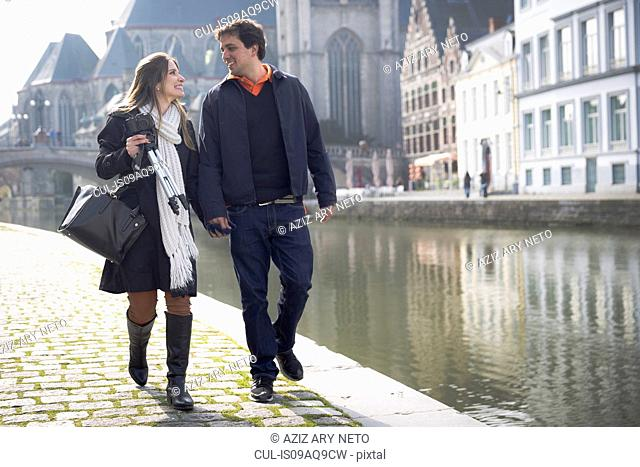 Couple strolling on Leie riverside, Ghent, Flanders, Belgium