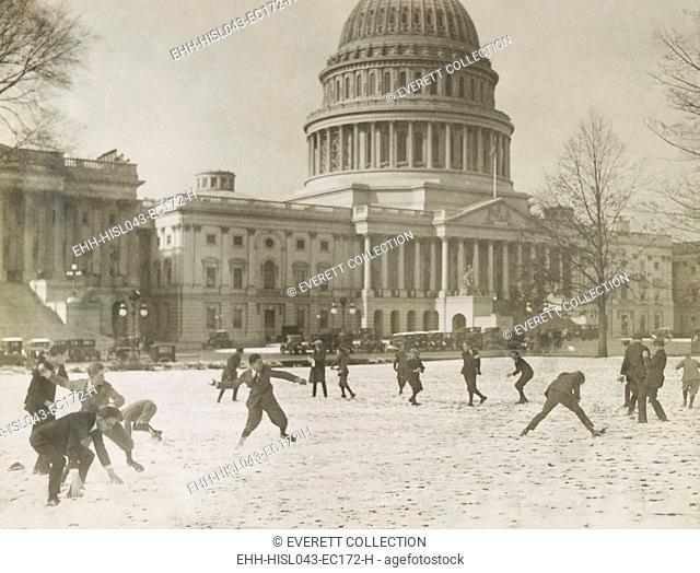 A Republican vs. Democratic snow ball battle at the Capitol among Senate page boys, Dec. 14, 1923 (BSLOC-2016-10-188)