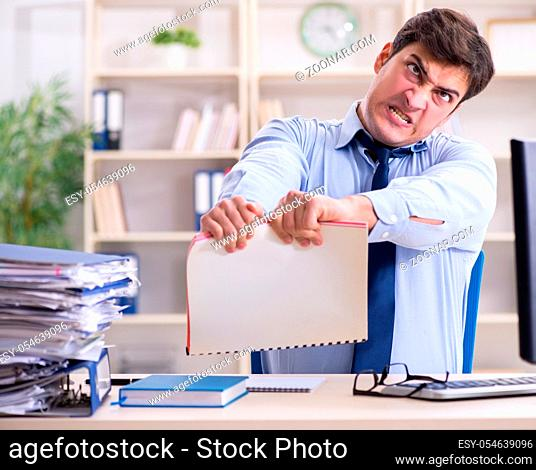 The tired businessman with too much paperwork