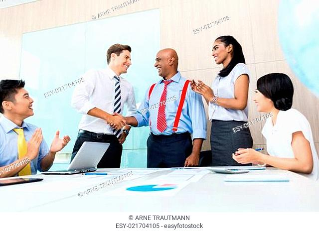 Diversity business team shaking hands