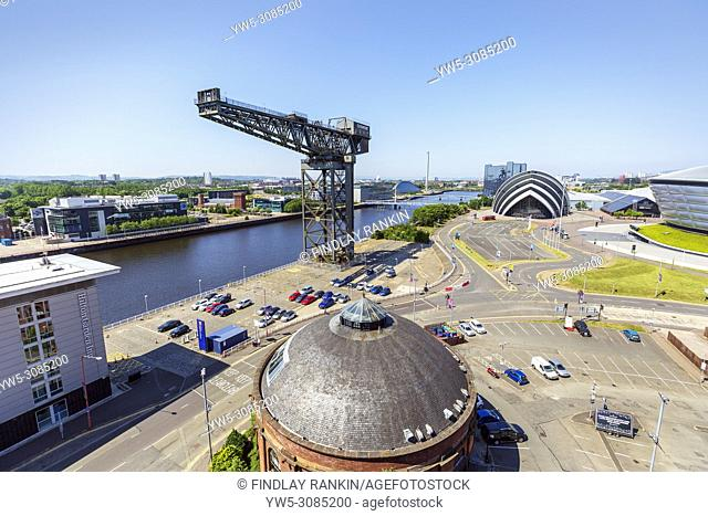 View west along the River Clyde with the Anderston crane, the Armadillo concert venue, part of the Scottish Exhibition and Conference Centre and STV Scottish...