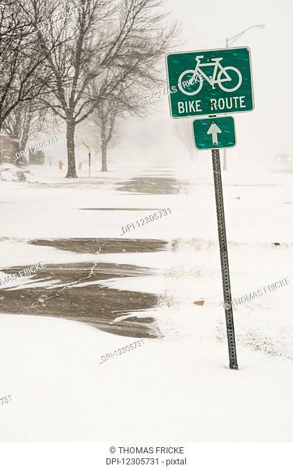 A bike route sign in a blizzard; Grand Forks, North Dakota, United States of America